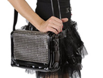 Black shiny bag with rows of pyramid studs
